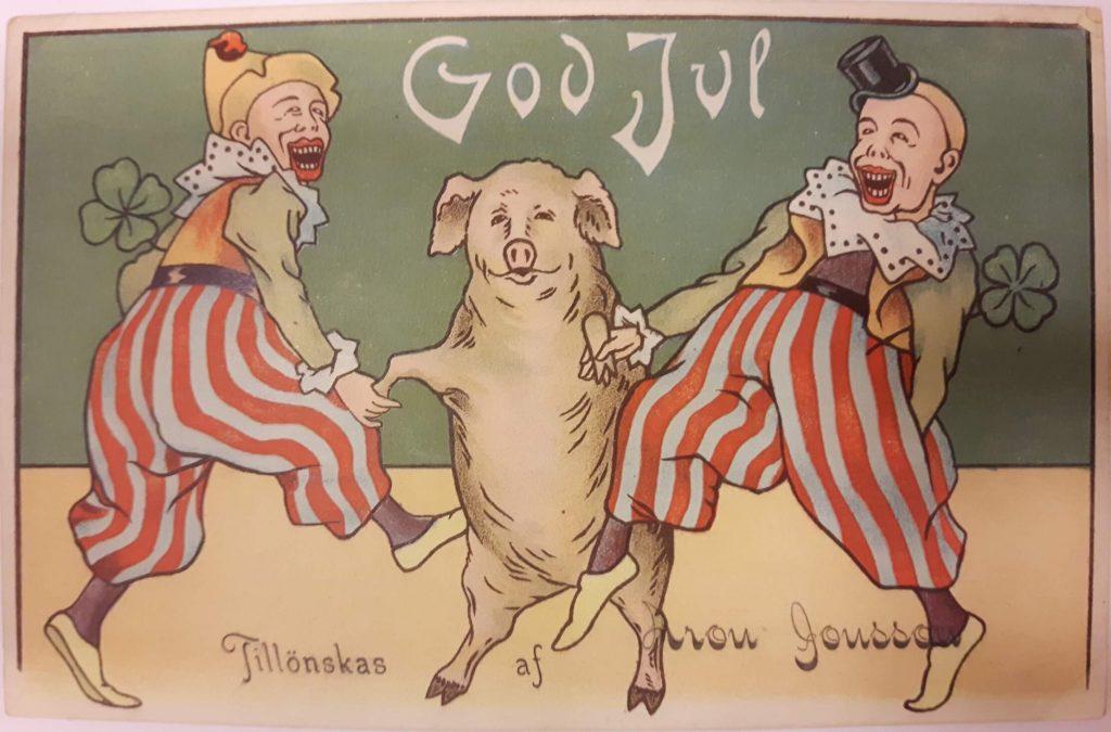 Joulukortissa tanssivat pellet ja sika