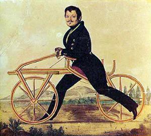 Piirroskuva Karl von Draisin juoksulaitteesta, joka muistuttaa varhaista polkupyörää, mutta polkimien sijaan vauhti saatiin jaloilla maasta potkimalla.